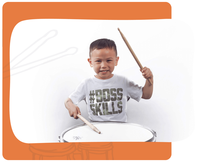 Young boy takes drumming lessons
