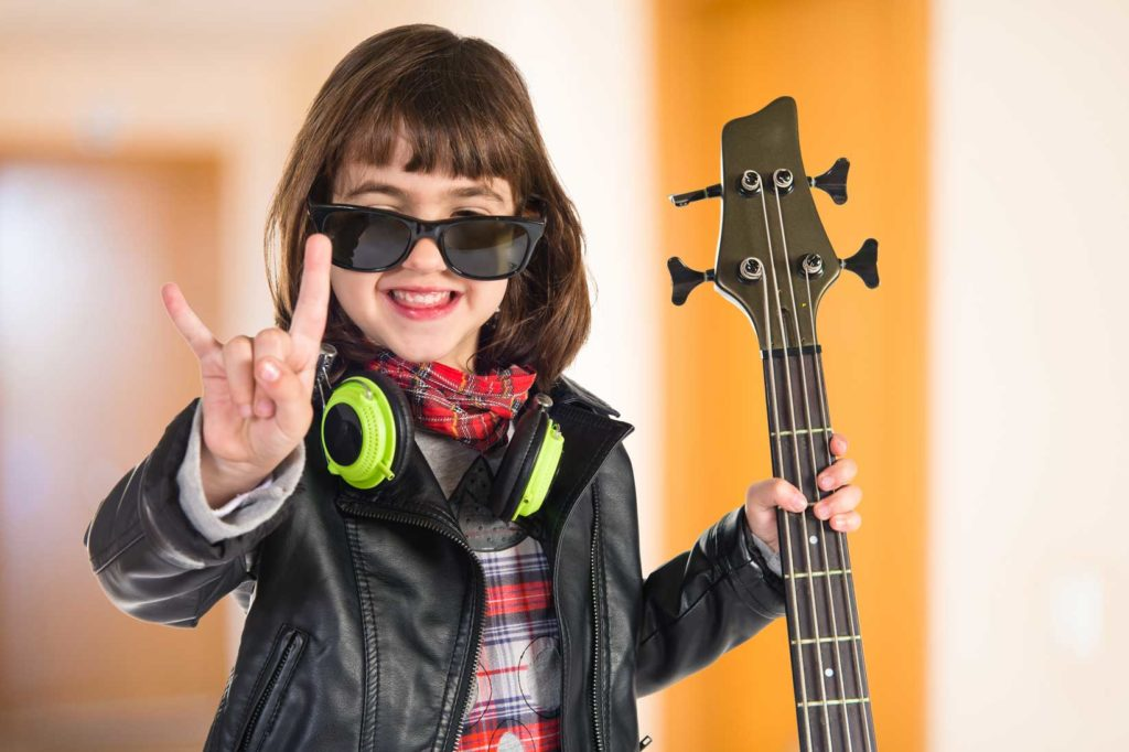 Happy Girl Holding Bass Guitar